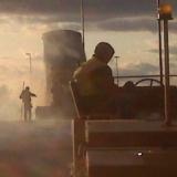 roller operator at sunset